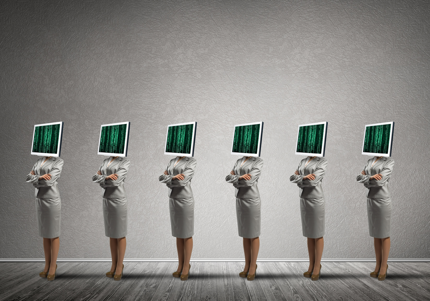 Business women with monitors instead of head.